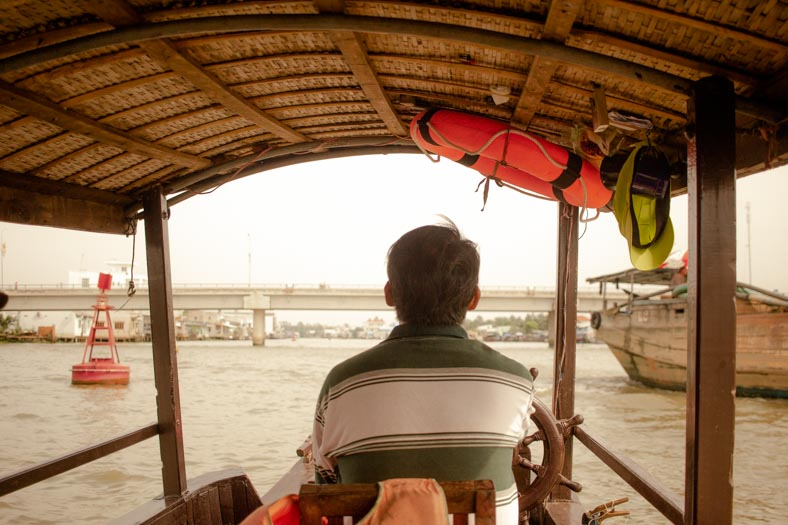 Mekong delta private tour - boat driver