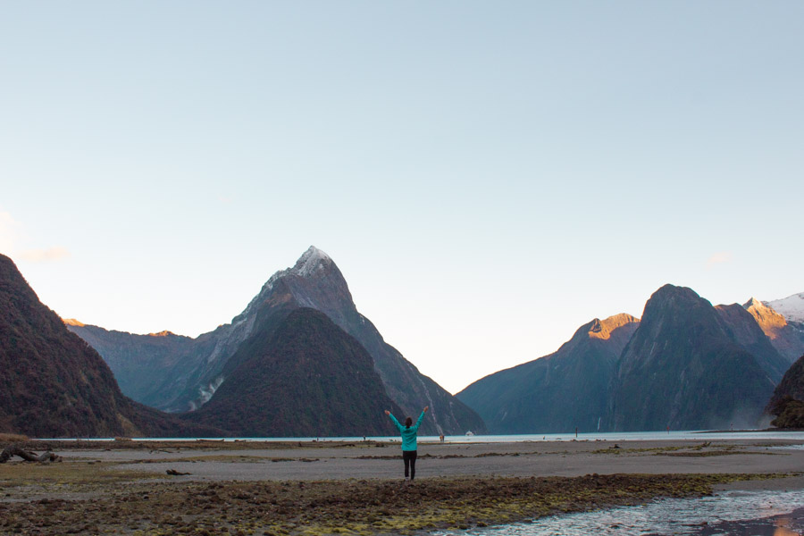 Girl looking out across Milford Sound on a dry day